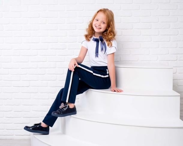 Девочка обута в детские кеды Woopy Fashion синие (7005) Фото 1