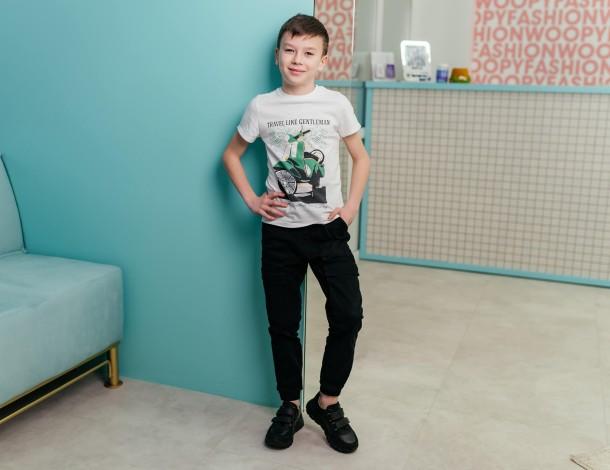 Девочка обута в детские кроссовки Woopy Fashion черные (8046) Фото 2